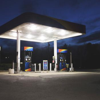 Gas station at night with two gas pumps