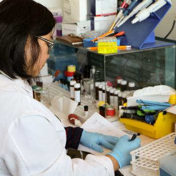 Lab tech testing in a lab